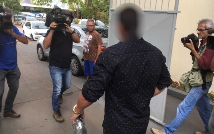Pai de aluno que atirou em colegas na escola presta depoimento em delegacia (Foto: Sílvio Túlio/G1)