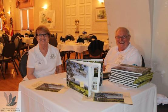 Gail Dixon and Bob Ring from the Historical Society display the book, Laguna Woods Village at 50 Years.