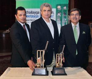 Mr. Zakir Khan Director Domestic Cricket PCB,Aarij Ali, Head Retail, Faysal Bank  Unveling the Trophy
