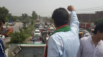 Imran Khan addresses crowds after claims gunshots were fired at his vehicle