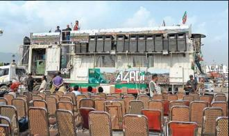 Imran Khan is addressing the empty chairs