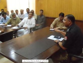 SP Security Malik Liaqat is presiding over a meeting
