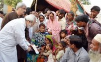 Kh Ahmad Hasaan gives a cheque of financial assistance to blast victim's family