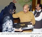 Shahbaz Sharif distributes laptops among students