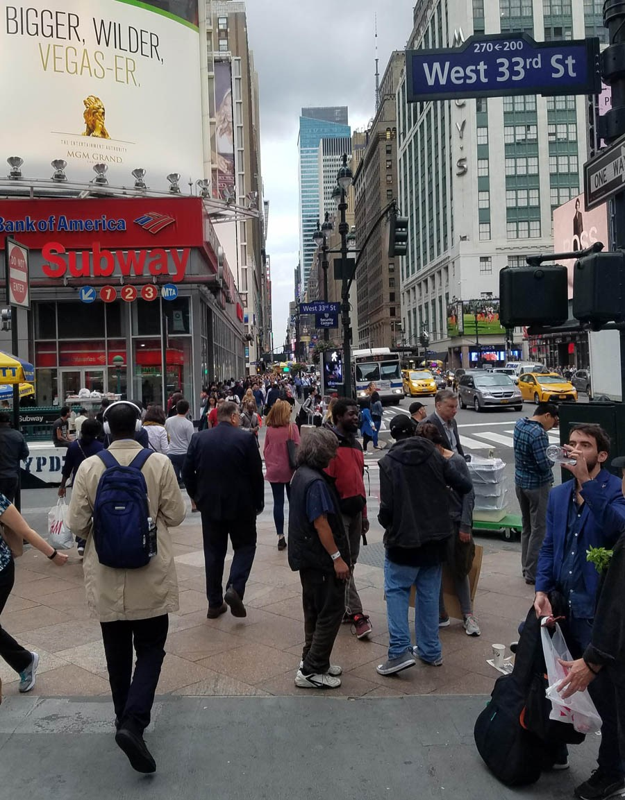 City street in New York crowded with people.