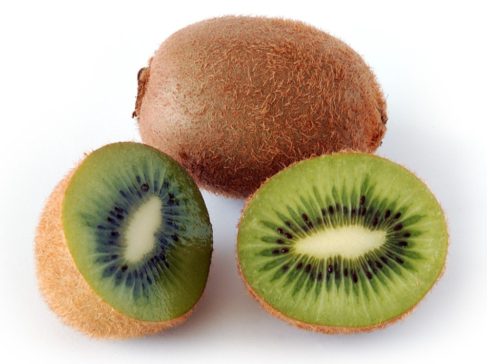 Traditional kiwifruit whole and cut in half.