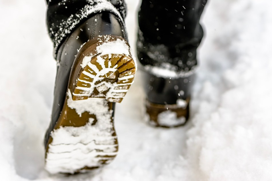 Boots compressing snow