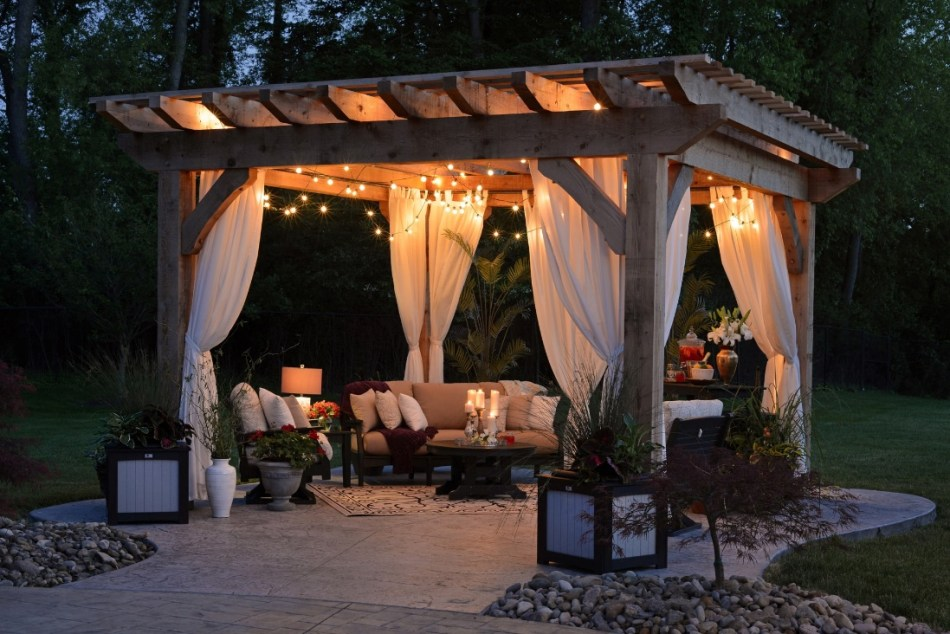 Multipurpose outdoor space with a gazebo, lighting and seating.
