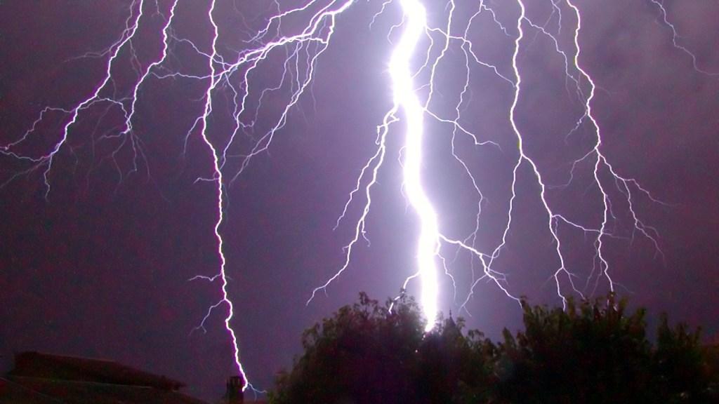 Tree being struck by lightning.