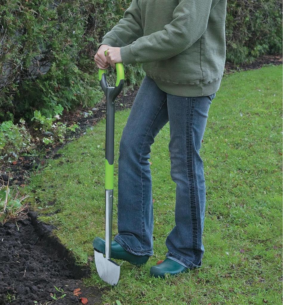 Half-moon edging tool cutting a lawn border.