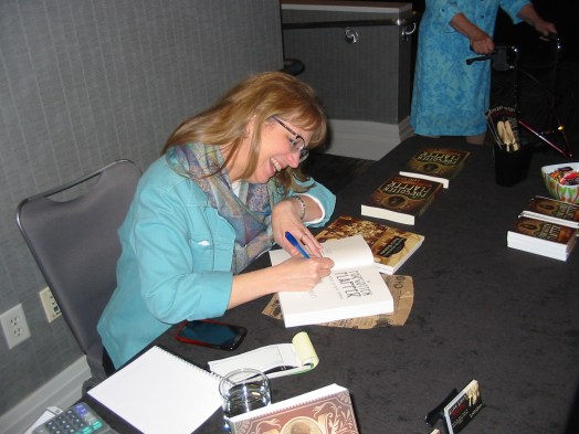 alt=Laini signing books in Hollywood