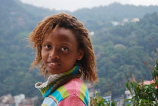 Roselane is fifteen years old and has one sister and three brothers. She likes to run and her favorite subject is math. She wants to be a singer when she grows up.