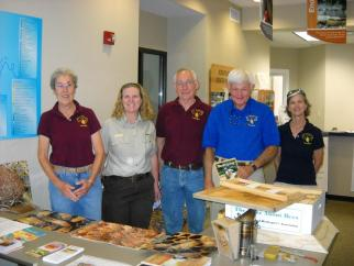 LCBA's table at the Wolf Creek Earth Day celebrations. (l-r) Hilary Forsyth, Wolf Creek Environmental Education Specialist Moria Painter, Ray Forsyth, Mike Wooton and Beth Wilson