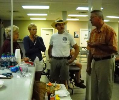 Pat Rizenbergs (left) and David Gilbert (right) chat with Carola and Jim Cason at the July LCBA meeting