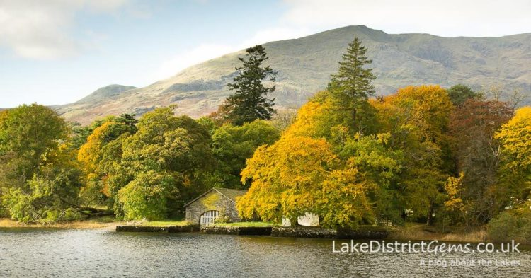 Boathouse on Coniston Water surrounded by autumn colours