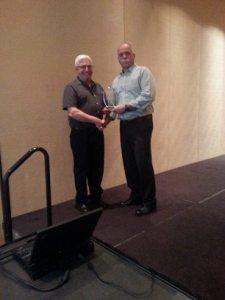 Doug Bassett (left) Accepting Lifetime Member Award from baseball Alberta