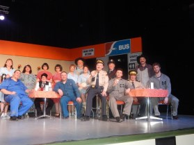 Entire cast (left to right): Velma Hudson as Linda, Kelly Burke as Bob/Angel, Dorothy Wuola as Chantico, Bert Poulin as Johnny Cash, Kiera Burke as Sherri, Kamryn Coleman as Mary, Shaun Sheplawy as Larry/Lucy, Doris Osinchuk as Maxine, Udo Mueller as Leroy, Shayla Cameron as Josie, John Seiben as Constable Larsen, Dixie Coleman as Annie the bus driver, Levi Jennings as Kevin, John Gottenbos as the Chief, Kendal Snyder as Bill, and Erik Sjolin as Mac.