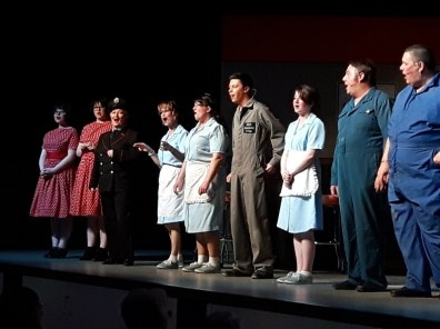 """The show ends with the cast singing, """"The Java Café and the Greyhound Depot, Where you meet all kinds of interesting people,"""" an original song written by Udo Mueller."""