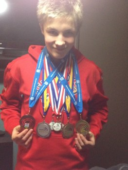 Mason with his medals to date