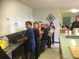 boys washing dishes