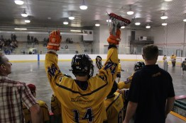 Aaron Goulet celebrates the North Championship