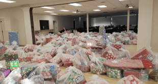 BCHS Santa's Elves prepare for annual gift-wrapping any way they can