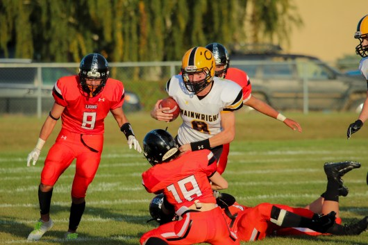 Kelton Mangatal tackles Drayton Townend, the Commandos' quarterback.