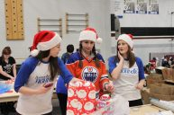 Santa's Elves & Oilers Fans work together to wrap presents
