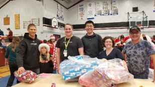 Staff & Students help wrap presents for Santa's Elves