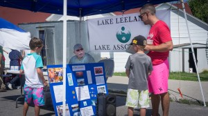 Nick Fleezanis speaking with some young riparians, August 15th, Lake Leelanau Street Fair.