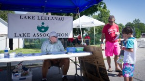 Vice President Nick Fleezanis speaking with some young riparians, August 15th, Lake Leelanau Street Fair.