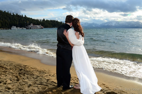 bride and groom on shore looking towards dixie