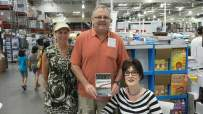 Signing books at Costco