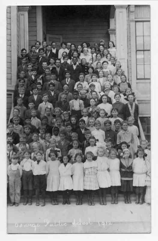 This image has an empty alt attribute; its file name is Oswego-school-children-1912-526x800.jpg