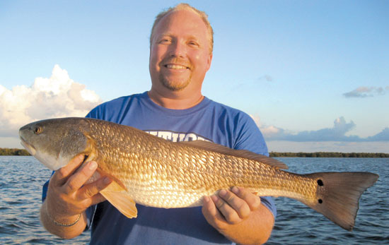 Darryl Horton with a nice redfish he caught while fishing with Capt. Ric Liles of Reel Simple Fishing Adventures.
