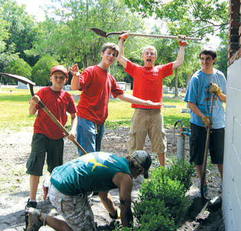 """Boy Scout Troop 12 in Lutz members wearing """"Class B"""" shirts while working outside. The scouts are from left Tyler Wilson, Joey Vars, Jimmy O'Dea and Drew Herridge. File photo."""