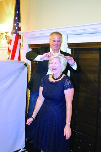 John Scott of Gulf Coast Financial Strategies 'passes the gavel,' so to speak, to incoming Greater Zephyrhills Chamber of Commerce president Carolyn Sentelik during the chamber's annual dinner Sept. 19. (Photo courtesy of Gary Hatrick)