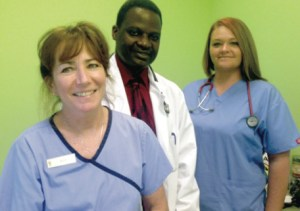 Pet Point's staff: Receptionist Mary Straub, veterinarian/owner Dr. Moses Kawalya and vet tech Jennifer Leali.