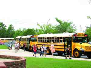 These children arrive at school at Quail Hollow Elementary School on the last day the school had classes before closing down for renovation. Quail Hollow is slated to open in the 2015-16 school year. (File Photo)