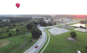 Tom Warren piloted a hot air balloon from American Balloons over New Tampa on a recent Thursday morning. In the distance, another balloon company is giving passengers a ride. Neither balloon traveled far that day because there was very little wind. (Photo by B.C. Manion)