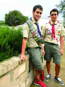 Twin brothers Jonathan Nystrom, left, and Joseph Nystrom II, will be awarded Boy Scout of America's highest honor Sept. 20, when each receives the Eagle Scout rank. Jonathan created a portable storage container for a fishing camp in Lakeland, while Joseph did landscaping work, including shrubbery like they're posing with at St. Rita Catholic Church. (Michael Hinman/Staff Photo)