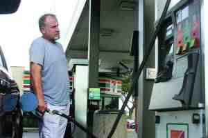 The talk of a gas tax did not stop Land O' Lakes resident Ron Cain from filling up his SUV at the 7-Eleven gas pumps on State Road 54 and U.S. 41. Motorists are slated for a smooth ride as the tax money generated will be used to build new Pasco County roads. (Fred Bellett/Photo)