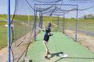 A player warms up in a batting cage at the Oscar Cooler Sports Complex. More batting cages are needed to meet the demand. (Courtesy of Lutz Baseball)
