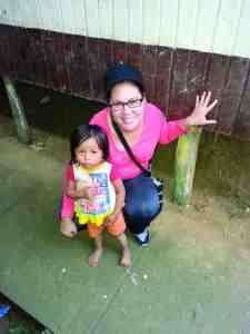 Mayra Santiago poses with a young child during the Wesley Chapel woman's trip to the Amazon. The hairstylist went with her church on a mission trip because she heard there was a need for someone who could cut hair. (Courtesy of Mayra Santiago)