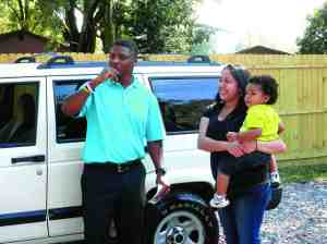 Warrick Dunn greeted Mary Maldonado and her son, Leonni, at the driveway of the house she was preparing to buy. He surprised her with a fully furnished home, a fully stocked kitchen, and $5,000 of mortgage assistance. (Michael Murillo/Staff Photo)