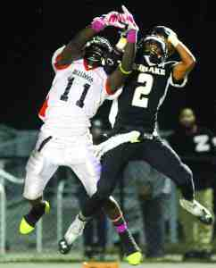 Sunlake's Terrence Jackson and Zephyrhills' Antwione Sims go up for a ball when the schools met late in the year, a game the Bulldogs won. Both football teams had big plans for 2014, and their hard work paid off during the season. (File Photo)