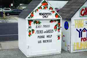 These Meals On Wheels 'doghouses' are receptacles stationed throughout Zephyrhills where residents can bring recyclables for the organization. The recycling helps fund the organization's operations, which are approaching $200,000 a year. (Courtesy of East Pasco Meals on Wheels)