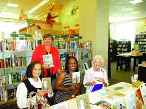 Some of the authors scheduled to be at the Barnes & Noble annual Local Authors Signing have taken part in the event in previous years. Shown here, from left are Susan Noe Harmon, Madonna Jervis Wise, Evelyn Taylor and Jamie Elizabeth Tingen. (Courtesy of Madonna Wise)