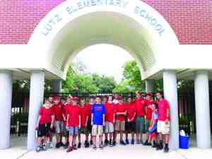 Troop 12 often does community projects, including this cleanup at Lutz Elementary School. (Courtesy of Mike Ritchie)