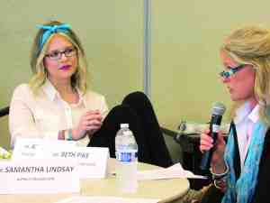 Ashleigh Pike, left, looks on as her mother, Beth Pike, describes the impacts that Ashleigh's illness has had on the young woman's life. (File Photo)